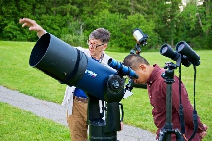 volunteer sharing a view through a telescope
