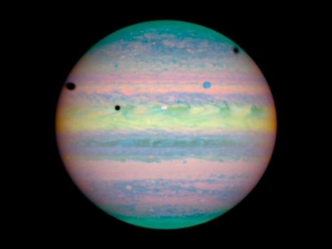 Moons castng shadows on Jupiter by NASA/ESA